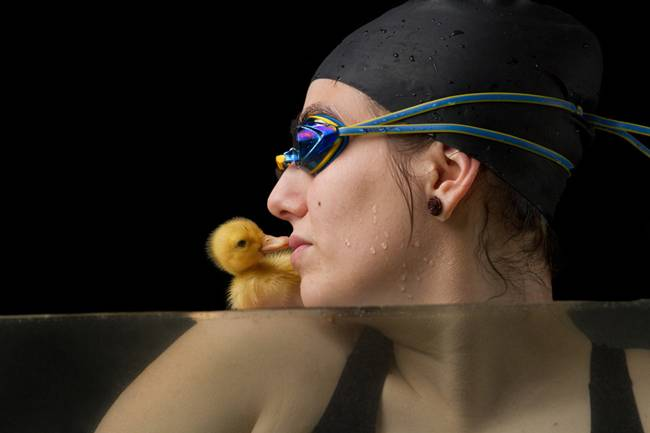 The Adorable Friendship Between a Swimmer & Her Duckling