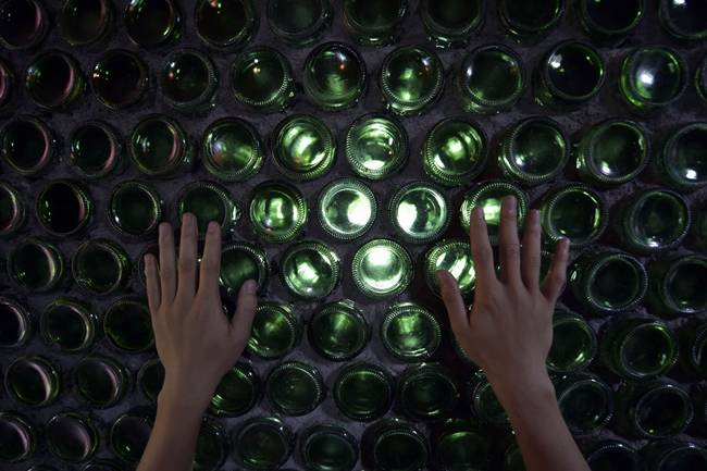 Architect built the office with 8500 beer bottles