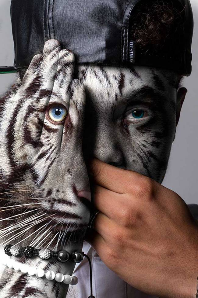Dramatic transformation of human faces in wild animals by Devin Mitchell