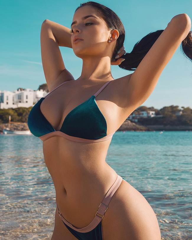 The camera and striking a pose — Demi Rose, British Model